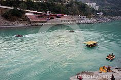 An active image of ferry boats, motor boats and rafts taking tourists for rides on the Ganges river in north India in the foothills of the Himalaya. Ferry Boat, North India, Motor Boats, Rafting, River, Mountains, Outdoor Decor, Image, Fountain Powerboats