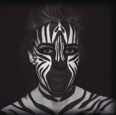 Zebra body-painting using snazaroo face paints and makeup.
