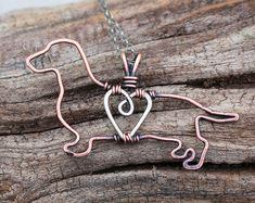 *Listing is for one necklace.*  The Yorkie is approximately 1 1/4 wide.  To view images of all dogs, please visit, http://karismabykara.com/home/gallery  My own original designs, each dog is carefully crafted out of sterling silver wire and copper wire (heart). Each is oxidized and polished to add dimension. Hangs on an oxidized sterling silver chain. Features a small hook clasp.  *This listing is for one necklace of your choice.*  If you do not see your breed, please contact me. This is a…