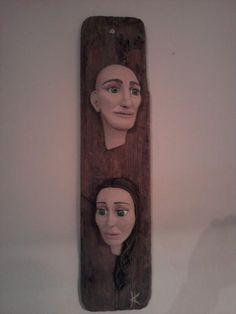 handmade sculpture with clay on wood