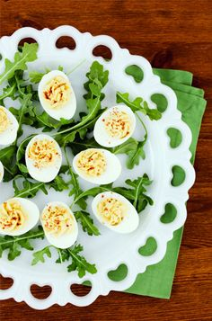 Deviled eggs on a tray with salad.