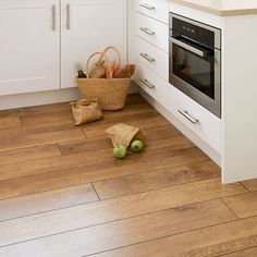 UK Flooring Direct Harvest Oak laminate planks are great for busy kitchens