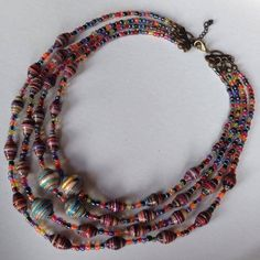 On SALE $ 40.00 Place your order: mari.margutti@hotmail.com  #jewelry #necklace #beads made from #magazine #glue #resin #handmade #handcrafted #upcycled #recycled #material #multicolor #unique #art #craft #designed by Mari M.