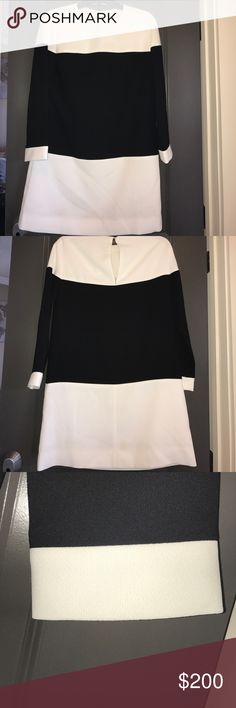 Kate Spade Color Block Dress Black and white dress. 100% polyester she'll and lining. Tags are still attached. Sleeves are 3/4 in length. Small button closure on back no zipper. kate spade Dresses Long Sleeve