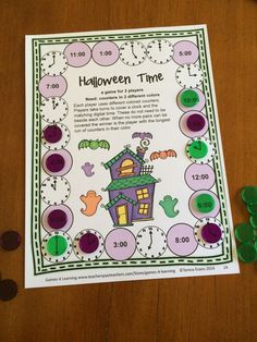 A telling the time game from Halloween Math Games First Grade by Games 4 Learning $