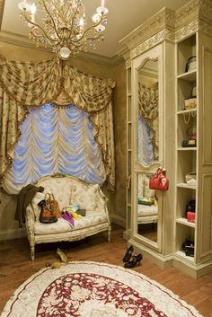 For the master dressing room, Haleh was faced with a number of challenges ‐‐ a third of the closet space was taken up by a large window and the other walls had obstacles and obstructions. Haleh's solution – to outfit the space with wall‐ to‐wall mirrored panels and storage areas by Habersham. Framed in a soft, hand‐styled Sandemar finish , the mirrors helped to dramatically open up the small 10 ' x 12' space.