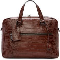 Structured leather briefcase is mahogany brown. Crocodile skin texture embossed throughout. Gunmetal-tone hardware. Two-way zip closure at main compartment with logo-stamped padlock. Adjustable removable shoulder strap. Carry handles at top. Zippered welt pockets at front and back faces. Keys for padlock and I.D. tag both on removable lanyards are handle base. Welt and patch pockets throughout interior. Fully lined in navy blue twill. Tonal stitching. Approx. 15
