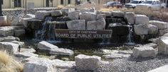 "This water feature in the front of the Cheyenne BOPU office is utilizing ""sump water"". The water table in the downtown area is very high and the fountain's water was pumped away from the building's foundation & used in the fountain. A grassy area to the right of the fountain will become a future ""Habitat Hero"" garden"
