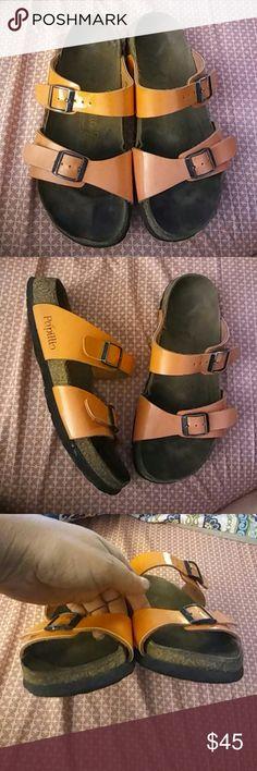Birkenstock Sydney Orange Patent. Sz 37 N Papillio by Birkenstock. Worn. Shows signs of wear. Shows small flat spots on soles. Tons of wear left in these. Freshly cleaned. Birkenstock Shoes Sandals