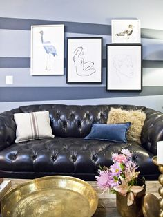 Brooks and Tiffany's finished apartment design featuring a tufted leather sofa, asymmetrical striped wall and gallery wall. (http://www.hgtv.com/hgtv-star/hgtv-star-season-8-photo-highlights-from-episode-3/pictures/page-20.html?soc=Pinterest)