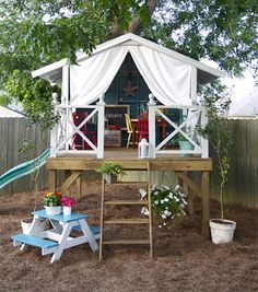 outdoor playhouse...Love how the picnic table is painted