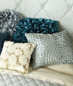 Tossing on a few iridescent pillows in shiny colors can make your bedroom sparkle