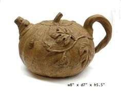 "This is a modern style Zisha clay teapot with new shape and color glaze. ( for collection or display purpose only )  Dimensions: w8"" x d7"" x h5.5""  Origin: China - Material: Zisha"