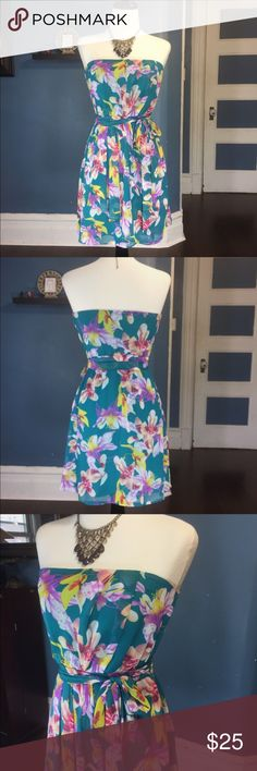 """Express Floral Print Strapless Summer Dress Express Floral Dress is beautiful and sexy.  Strapless with hidden zipper on the left side. It has a self tie belt that goes over an elastic waist. Fully lined. Bodice and lining are 100% polyester. Approximate measurements (measured flat): bust: 14""""; waist: 11.5"""": length: 27"""". Excellent used condition. No signs of wear. Express Dresses Strapless"""