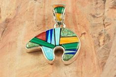 Calvin Begay Bear Pendant. You can view the entire collection of Calvin Begay Jewelry here: http://www.treasuresofthesouthwest.com/calvin-begay-jewelry.html