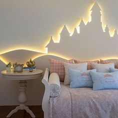 something like this with large evergreen shapes with rope backlighting to cover a full wall