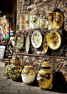 Ceramic Shop in Tuscany, Italy the perfect place for adding that touch of color to your home alone with ceramic chickens and throw pillows and rugs and curtains and lamps ETC...