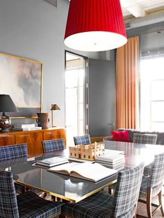 Trends to Steal From Every Decade via @MyDomaine Principal of Michael Aiduss Interior Design Michael Aiduss's studio workspace is a vision in plaid. Pattern ruled the 1950s with a gingham and tartan clad fist. Aiduss's vivacious pop of red is the perfect foil for subdued grays and cool blue hues. Call it the Pleasantville effect.