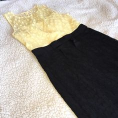 MILLY of NY yellow and black lace dress GORGEOUS Milly of NY black and yellow laced dress with black button and zipper in the back and black bow accent in the front. Beautiful and soft with 100% silk lining underneath. Dry clean only. Only worn once by my friend to an event. She gave this to me before moving but not my size Milly Dresses
