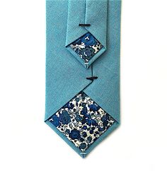 A personal favourite from my Etsy shop https://www.etsy.com/uk/listing/511194192/dusky-blue-tie-with-liberty-print-lining