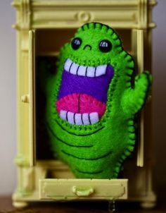 felt slimer plushy this one made by nuffnufftoys on Etsy