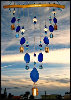 I live in a beautiful town in Mexico called Puerto Penasco. It is along the coast of the Sea of Cortez that I personally collect some of the sea glass that I use in my creations. This wind chime/ mobile is made from cobalt blue beach glass. It has white and blue starfish beads