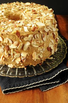 Espresso Angel Food Cake goes the easy route with a cake mix flavored with instant espresso. The cake is slathered with a rich espresso-flavored icing, then randomly studded with toasted sliced almonds. Easy Desserts, Delicious Desserts, Dessert Recipes, Yummy Food, Angle Food Cake Recipes, Coffee Icing, Gateaux Cake, Salad In A Jar, Angel Food Cake