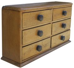 19th century six drawer Apothecary, with old mustard paint, all square nailed case, with dovetailed drawers. (1850 )