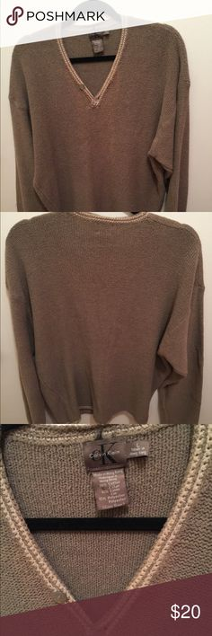 Calvin Klein lightweight knit brown sweater Light brown and lightweight, a great spring addition.  Accent beige stripes along the sleeves and neckline along with some button details at the neck.  Slightly boxy cut.  Cotton/linen. Calvin Klein Sweaters V-Neck