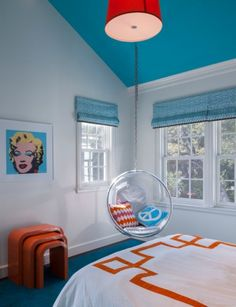 There's a very 1970′s meets 2013 feel to this space.  I'm sure both boys and girls would love this room.  Marilyn Monroe and a bubble chair.  What's not to love!
