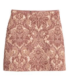 Short skirt in textured, jacquard-weave fabric with glittery threads. Snap fastener and concealed zip at back. Lined.