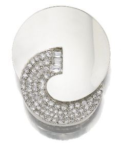 The brooch is an exceptional example of the Abstract trend in Art Deco during the 1930's. The balanced design of the two circles represents ying and yang and the concave surface of the platinum element reflects the light of the diamonds one. As in life, it is the contrast that makes one complete.