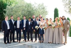 dcb949d355f groomsmen in navy and bridal party in toupe Male Bridesmaid