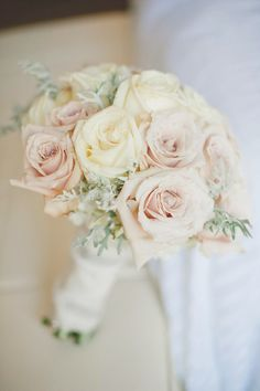 blush bouquet with babies breath. But with something other than roses.