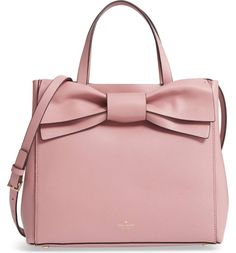 An oversized bow adds vintage cosmopolitan charm to a lightly structured satchel in buttery-soft pebbled leather.