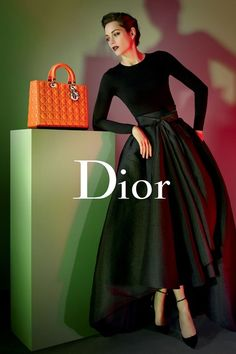 Marion Cotillard for Lady Dior. This has a very 50s feel to it with the full skirt.