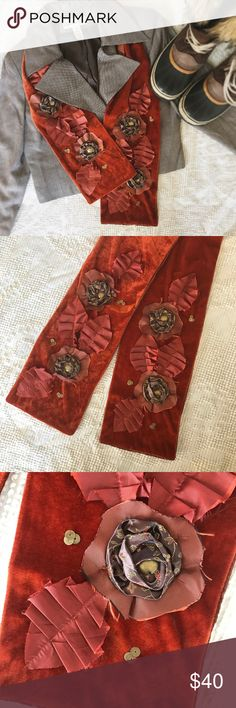 """VintageScarf with flowers VintagePumpkin and brown toned velvet and silk scarf. This item is ONE OF A KIND! You'll never find anything else like it. Pair it with vintage Christian Dior and some snow boots for a cozy fall feel. 56"""" long and 6"""" wide, this scarf features hand sewn silk flowers and brass like buttons, silly leaves and brassy circular flat beaded accents. Stunning!!! One minor flaw on the BACK of scarf two tiny stains. Can be dry cleaned. Vintage Accessories Scarves & Wraps"""