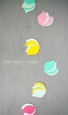 This DIY paint swatch flower garland would make a great table decoration at a bridal shower!
