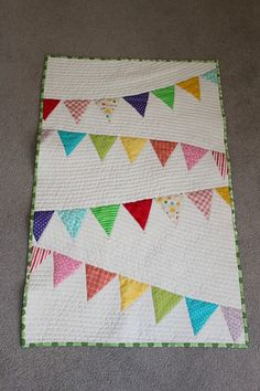 I made this quilt using the tutorial from http://www.aprettycoollife.com/2010/07/rainbow-bunting-baby-quilt-tutorial.html . I added machine quilting.
