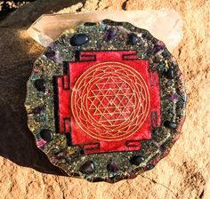 The Sri Yantra Orgonite Charging Plate is a powerful energy balancing tool created with the intention to protect, purify and inspire a deeper connection to your Higher Self. A yantra, in Hinduism and Buddhism, is a geometric figure that embodies a chant or mantra. The Sri Yantra emanates from the sound of Om. It is known as the Mother of All Yantras, consisting of 9 interlacing triangles, with a space in the center where all life manifests. Meditation on the Sri Yantra takes us to the…