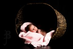 A cute twist on the basket portrait.. Oversized basket with baby