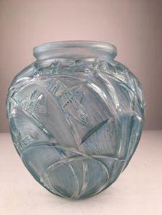 "R. Lalique ""Sauterelles"" vase with a teal patina."