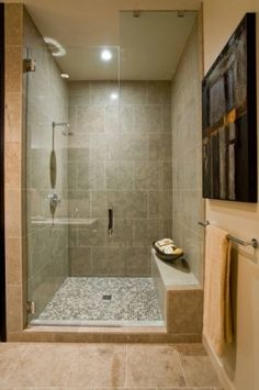 Large tile in shower in Master bathrooom- needs an accent line.  Don't like the floor as much.