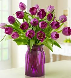 Purple / lilac tulips flower arrangement with purple / lilac vase