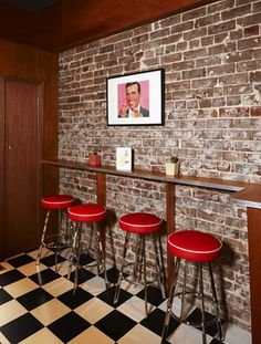 This would make a cool bar. Brick wall, red bar stools, checker floor. I love it.