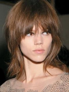 Medium shag layered hair with bangs