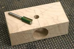 Next drill a hole through the face of the block of a diameter to match that of the cutter you are going to use to form the dowel
