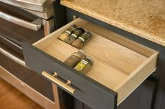 Get your spices under control with this DIY Spice Drawer Organizer. It's customized to fit within your kitchen drawer.