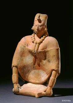 justin Kerr image: Image:  3110a  File date:  2001-06-16  Caption:  Elite Lady  Description:  Maya. Jaina. clay with traces of paint. Seated woman wearing huipil. height 19.0 cm
