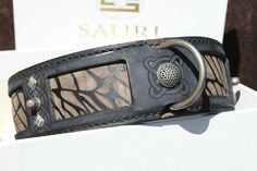 Genuine leather dog collar with blue overlayer and unique brown handprinted underlayer. Hand antiqued. With silver patina ornaments.  Durable wear, resistant to cracking and streching. Hand-stitched in 3 leather layers, each 4mm thick full grain leather.Where the largest exposure to pressure (buckle, D-ring) – the collar is strenghtened with the fourth layer of leather. Made by Workshop SAURI